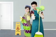 Two janitors with cleaning equipment Stock Photos