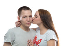 Image of two kissing teenagers. On white background Stock Photo