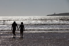 The image of two people in love at sunset. In Essaouira, Morocco stock photography
