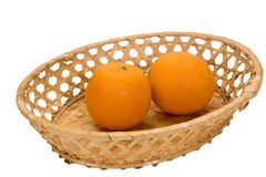 Two ripe oranges in a wicker plate Stock Photography