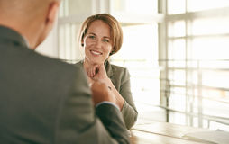 Image of two succesful business people conducting an interview to hire their next employee royalty free stock images