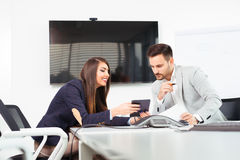 Image of two successful business partners working at meeting in office Stock Photo