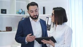 Image of two successful business partners working at meeting in office.  stock footage