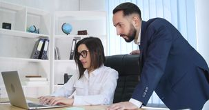 Image of two successful business partners working at meeting in office stock video footage