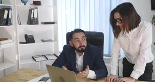 Image of two successful business partners working at meeting in office.  stock video
