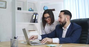 Image of two successful business partners working at meeting in office.  stock video footage