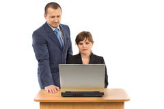 Image of two working people. Looking at laptop screen in office Royalty Free Stock Photos