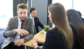 Image of two young business people interacting at meeting in office. Stock Photography