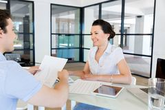 Image of two young business people in office Royalty Free Stock Photos