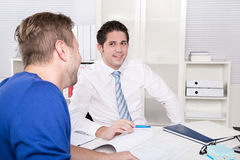 Image of two young businessmen at meeting Stock Images
