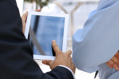 Image of two young businessmen using touchpad Stock Photo