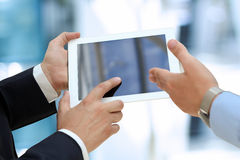 Image of two young businessmen using touchpad Royalty Free Stock Photos