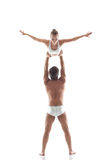 Image of two young gymnasts - man holds slim girl Royalty Free Stock Image