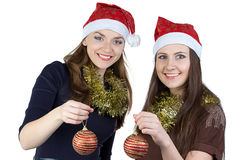 Image of two young women with christmas balls Royalty Free Stock Photography