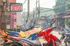 Image of Unidentified motorcycle for rent and tourists in Chian Stock Images