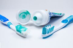 Image of used old and new toothbrushes isolated on a white backg Stock Photos