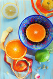 Image of various citrus fruits and ginger on blue cutting board Stock Photo