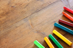 Image of various colorful crayons on wooden table Royalty Free Stock Images
