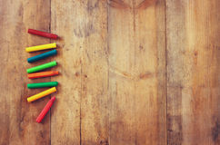 Image of various colorful crayons on wooden table Royalty Free Stock Image