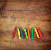 Image of various colorful crayons on wooden table Stock Photos