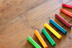 Image of various colorful crayons on wooden table Stock Image