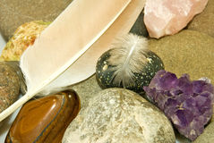 Image of various stones and feather closeup Royalty Free Stock Photography