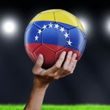 Venezuela flag in hands. Image of Venezuela flag in hands royalty free stock photos