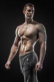Image of very muscular man posing with naked torso Stock Photos