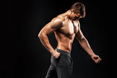 Image of very muscular man posing with naked torso Stock Images