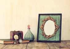 Image of victorian vintage antique classical frame, jewelry and perfume Stock Photo