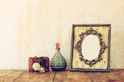 Image of victorian vintage antique classical frame, jewelry and perfume Royalty Free Stock Images