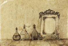 Image of victorian vintage antique classical frame, jewelry and perfume bottles Royalty Free Stock Image