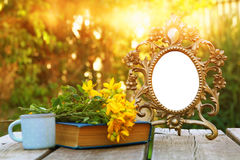 Image of vintage antique classical frame on wooden table Stock Image
