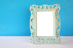 Image of vintage antique classical frame on wooden table Royalty Free Stock Image
