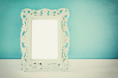 Image of vintage antique classical frame on wooden table Royalty Free Stock Photo