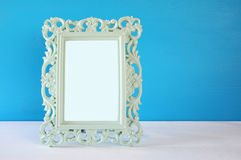 Image of vintage antique classical frame on wooden table Royalty Free Stock Images