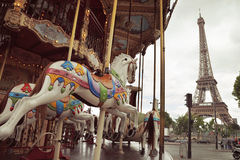 Image of vintage carousel near Eiffel tower in Paris, France Stock Image