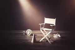 Image with vintage texture of a Director chair and movie items royalty free stock photo