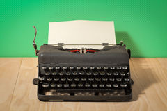 Image of vintage typewriter on green wallpaper Stock Image