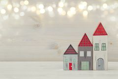 image of vintage wooden colorful houses decoration on wooden table Stock Photo