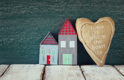 Image of vintage wooden colorful houses and fabric heart Royalty Free Stock Image