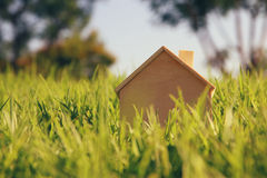 Image of vintage wooden toy house in the forest Royalty Free Stock Photography
