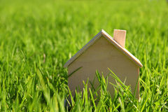 Image of vintage wooden toy house in the grass Royalty Free Stock Photos
