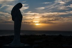 Image of the virgin Maria protecting from a hill the island of Coche, in the Venezuelan Caribbean. Stock Image