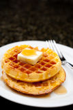 Image of waffles covered in maple syrup Royalty Free Stock Images