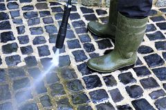 An Image of walkway cleaning - high pressure cleaner. Dirty, Job - abstract royalty free stock photos
