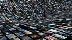 Image wall with many video screens. A 3D rendered image of a video wall. A curved media image screen which shows many small monitors royalty free illustration