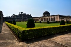 Bidar, India - December 17, 2017: Garden in Solah Khamba Mosque inside Bidar Fort in Karnataka, India royalty free stock images