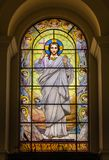 Christ on the stained glass window stock images