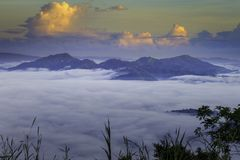 Beautiful landscape of a cloud inversion and mountains in the distance royalty free stock images